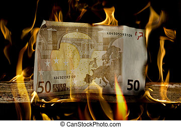 50 Euro money bill on wood just about to burn - A single 50...