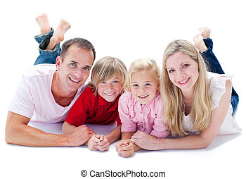 Cheerful family lying on the floor against a white...