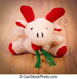 Plush Christmas reindeer on wooden background