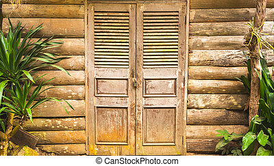 Old wooden barn door and wood wall