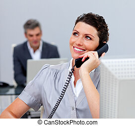 Attractive business woman on phone in the office