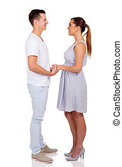 young couple holding hands - romantic young couple holding...