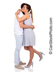 young woman hugging her boyfriend - beautiful young woman...