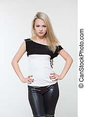 Beautiful girl in black leather pants. on a white