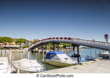 Pedestrian bridge in Grado city center, Italy - Pedestrian...