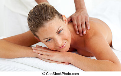 Smiling woman having a spa treatment