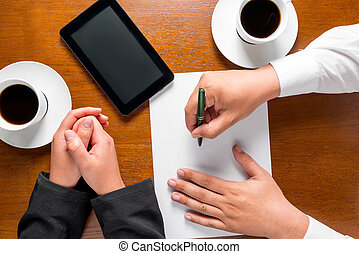 business partners hands on the table top view