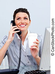 Enthusiastic business woman on phone