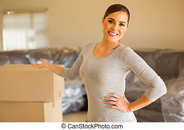 young woman presenting her new house