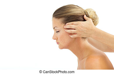 Cheerful woman having a head massage in a spa