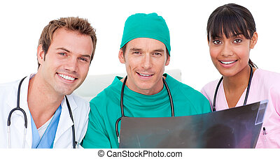 Portrait of medical team looking at X-ray against a white...