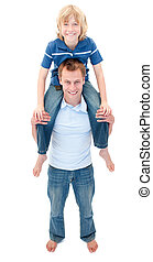 Portrait of father giving his son piggyback ride against a...