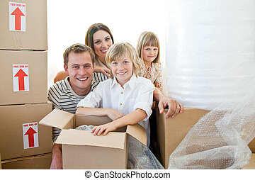 Loving family packing boxes while moving house