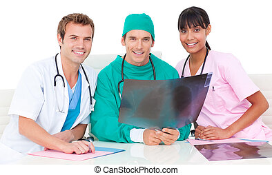 Smiling medical team looking at X-ray - Smiling medical team...