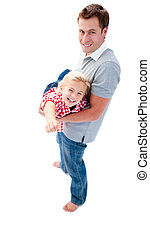 Joyful father giving his daughter piggyback ride against a...