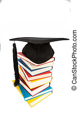 mortar board on books stack - a mortar board on a pile of...