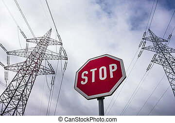 power line and stop sign - a pole of a power line and a stop...