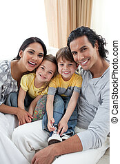 Cheerful family sitting on a sofa