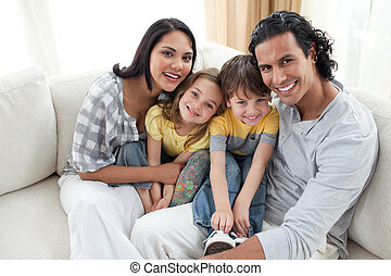 Merry family sitting on a sofa