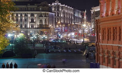 People walking on Manezh Square at night in Moscow Tverskaya...
