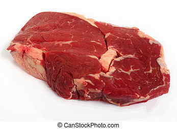 Raw ribeye steak on a white background