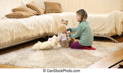 child plays with dolls