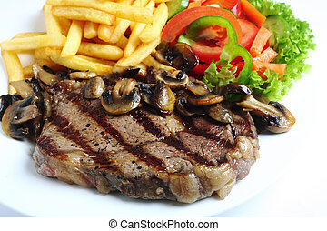 Grilled ribeye steak dinner - A grilled ribeye steak served...