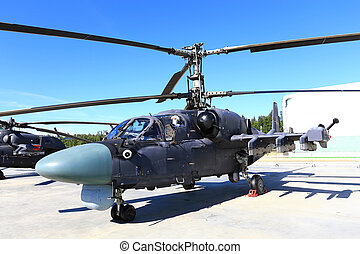 Combat helicopter - Attack helicopter is armed with rockets,...