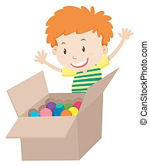 Little boy and box full of balls