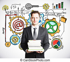 Businessman with books on concept business scheme background