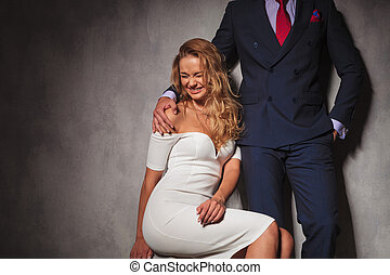blonde sexy woman laughing with her man near