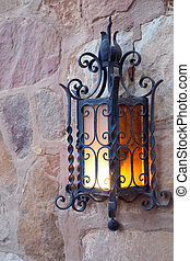 Old  lantern   -  Old decoration lantern on a stones wall
