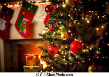 decorated fireplace and Christmas tree at cottage -...
