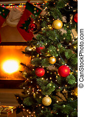 background of decorated Christmas tree and fireplace