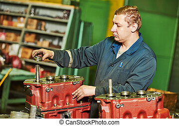 assembler worker at tool workshop - industrial worker...