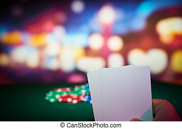 Poker chips with blank cards on table in casino