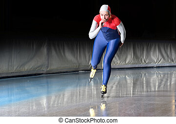Speed skater at speed - Speed skater emerging on the...