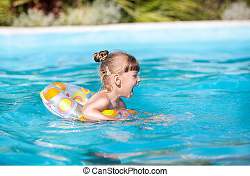 Happy Little Girl In The Pool