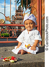Portrait of balinese child in traditional costume - Sarong -...