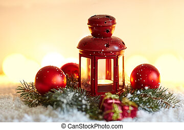 Christmas background with fir tree and lantern in snow