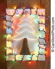 Decorative fir tree in christmas lights frame