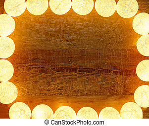 Lights frame on wooden background with copy space