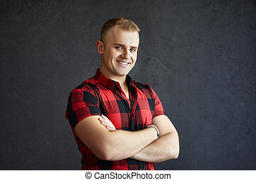Handsome smiling man - Portrait of handsome smiling man in...