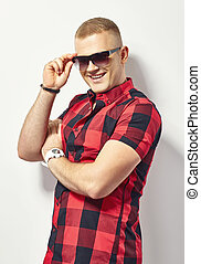 Smiling stylish man in sunglasses - Smiling stylish man in...