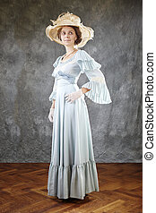 Lady of old times in ancient secession-style apparel and hat...