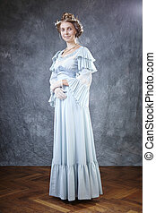 Posing in studio in old style - Lady of old times in ancient...