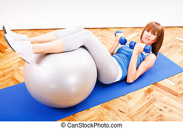 Fitness Training - Fitness girl doing exercise with pilates...