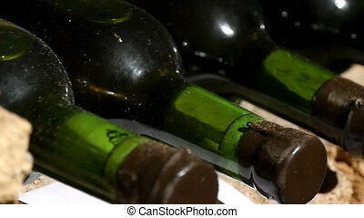 Rows Of Wine Bottles In Storage - Rows of wine bottles in...