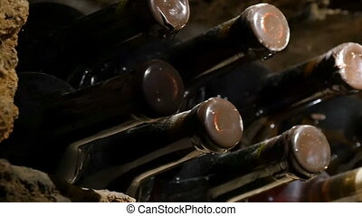 Close Up Of The Wine Bottles In A Wine Cellar - Slow right...