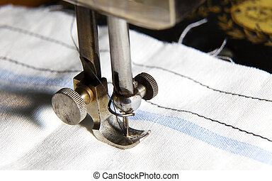 Stitching machine detail close-up with textile